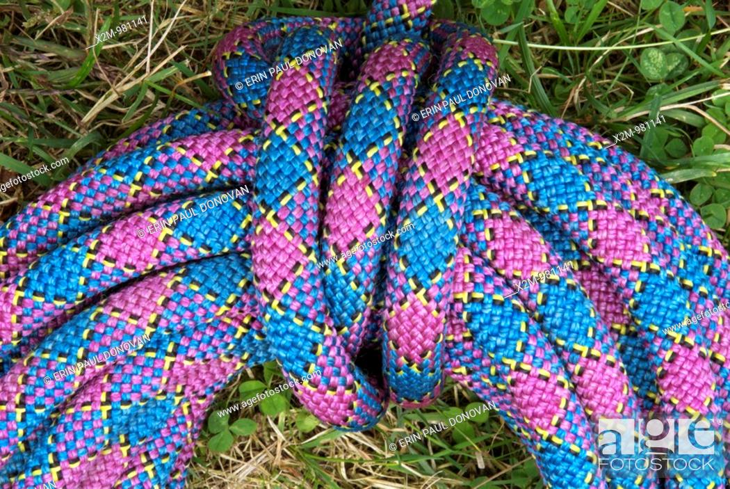 Stock Photo: A purple climbing rope on the ground.
