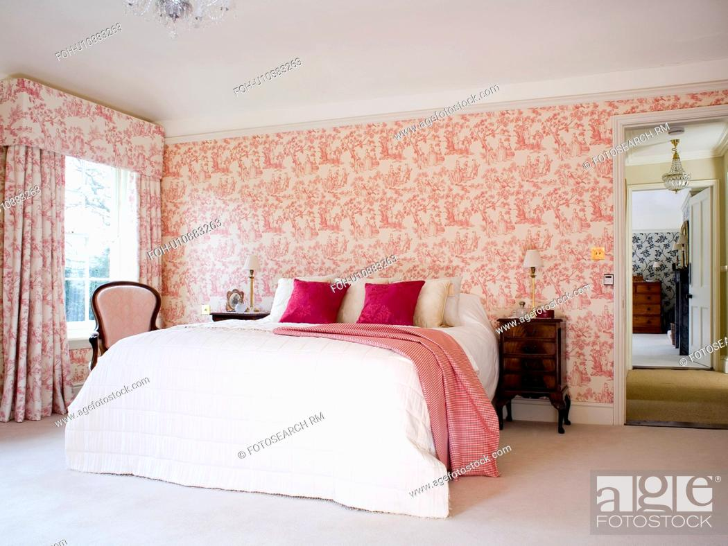 Stock Photo: Pink Toile De Jouy Wallpaper And Curtains In Country Bedroom  With