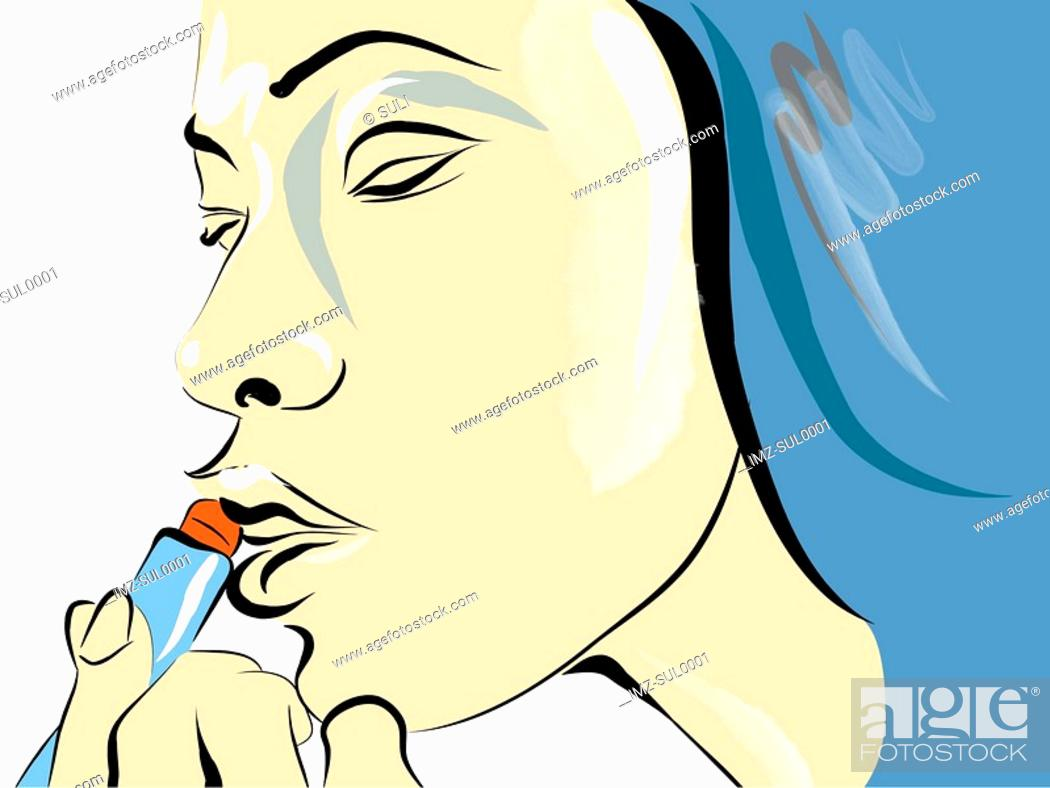 Stock Photo: A woman putting on Lipstick.