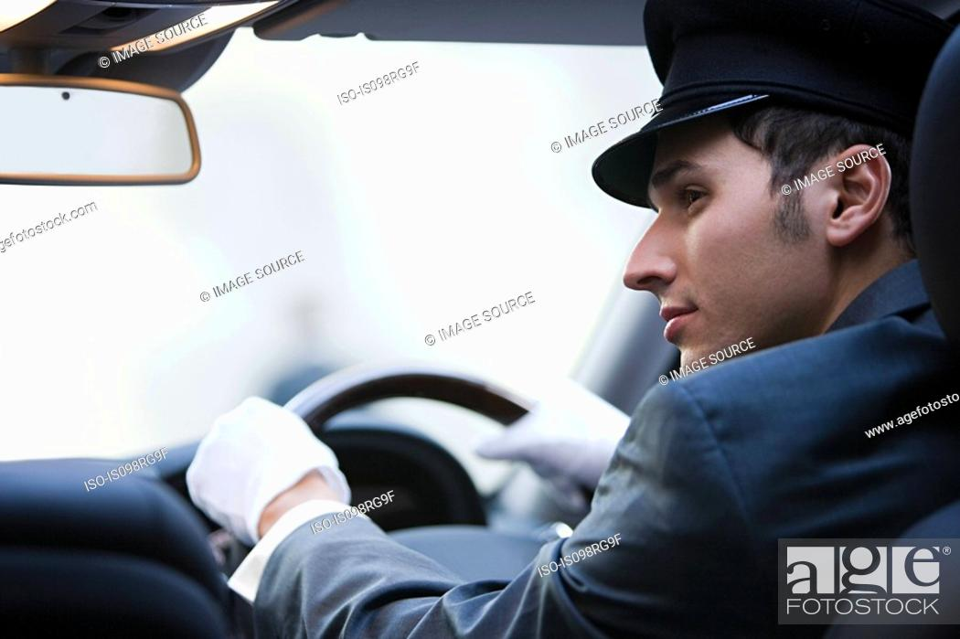 Stock Photo: Male chauffeur driving.