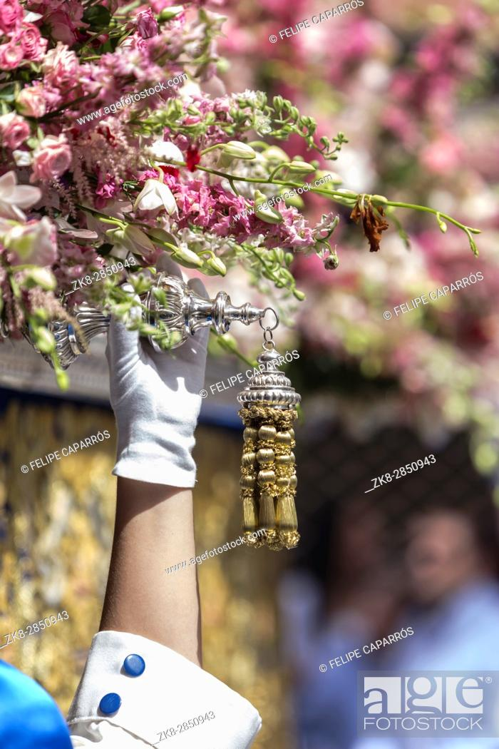 Stock Photo: Nazarene that goes with the hand on the manigueta the throne in a procession of holy week. Not wearing capirote, and the mask falls loose by the head, back.