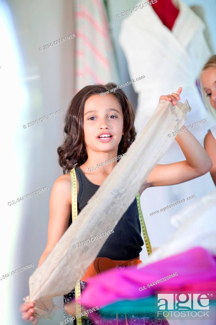 Stock Photo: Girl playing fashion designer.