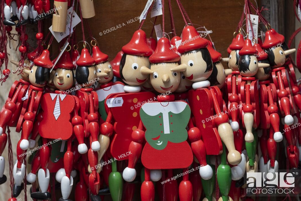 Stock Photo: Scores of Pinnochios Wait for a Child's Attention in Store in Assisi Umbria Italy World Location.