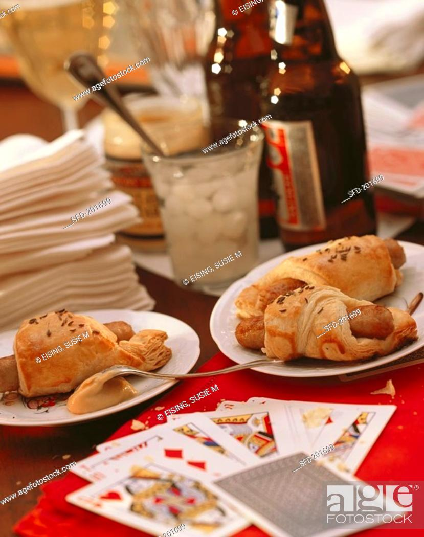 Stock Photo: Party Table Scene with Pigs in a Blanket and Beer, Cards.