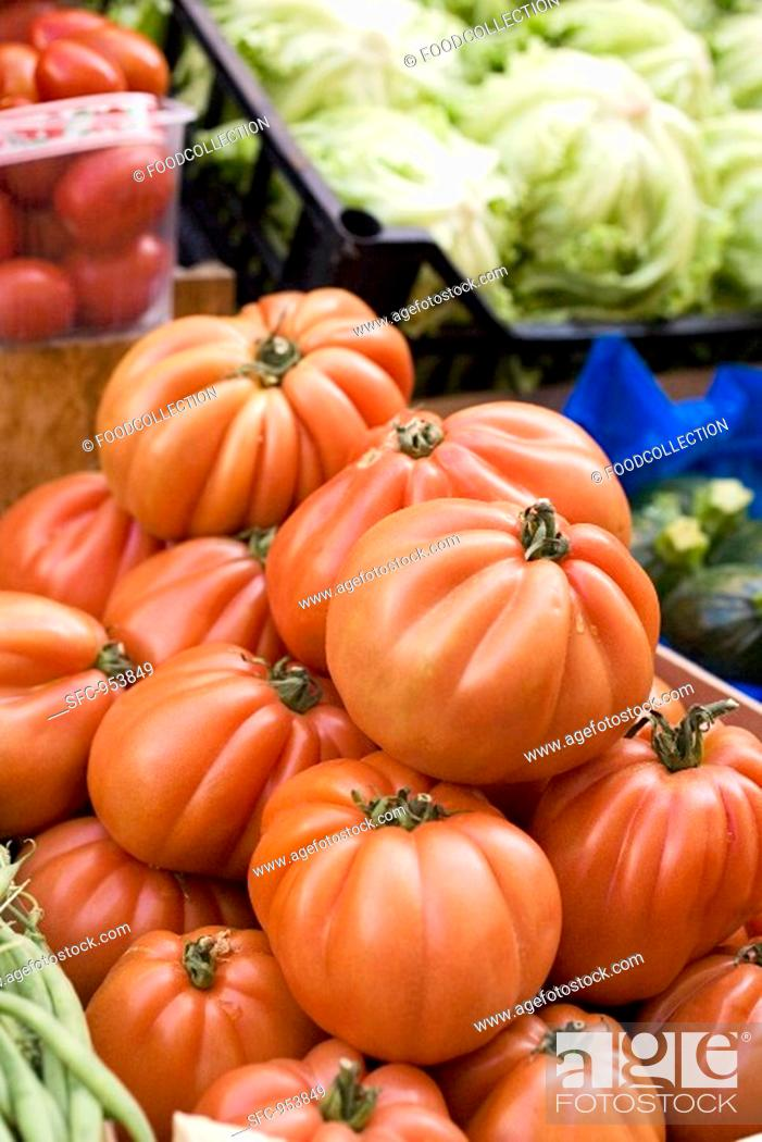 Stock Photo: Large beefsteak tomatoes in a crate at a market.