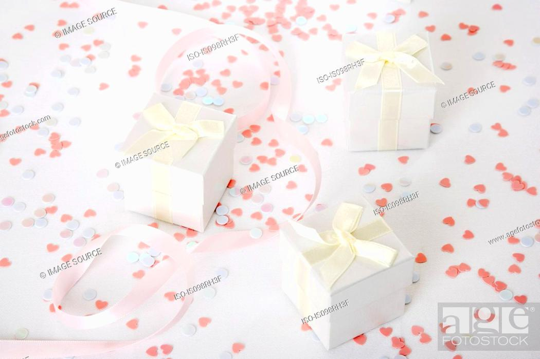 Stock Photo: Wedding gifts and confetti.