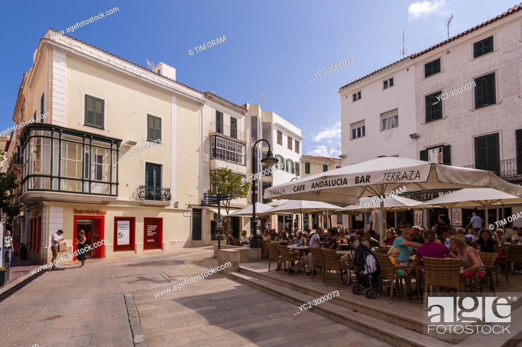 Stock Photo: People sitting outside at a bar cafe in Mahon , Menorca , Balearic Islands , Spain.