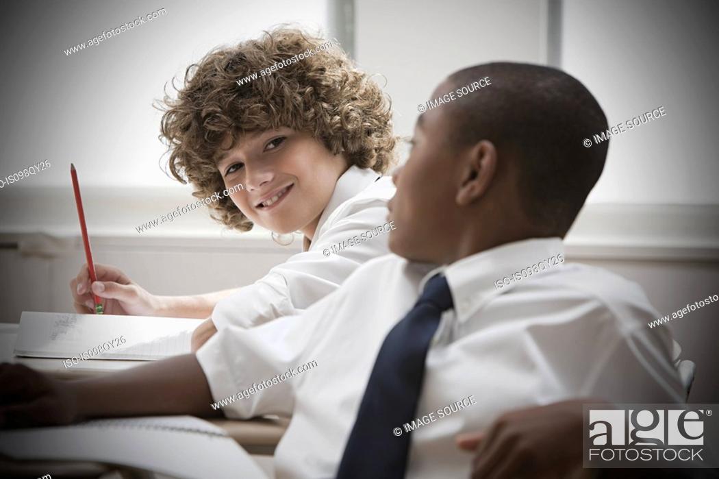Stock Photo: Boys in classroom.