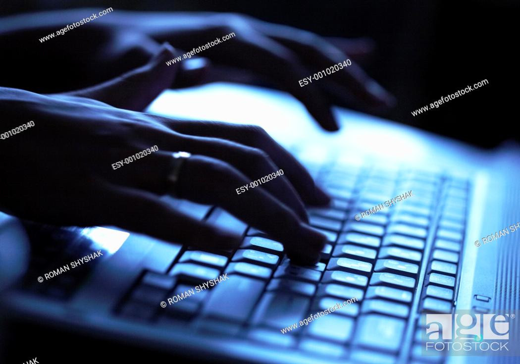 Stock Photo: Close up of a hands typing on laptop keyboard.