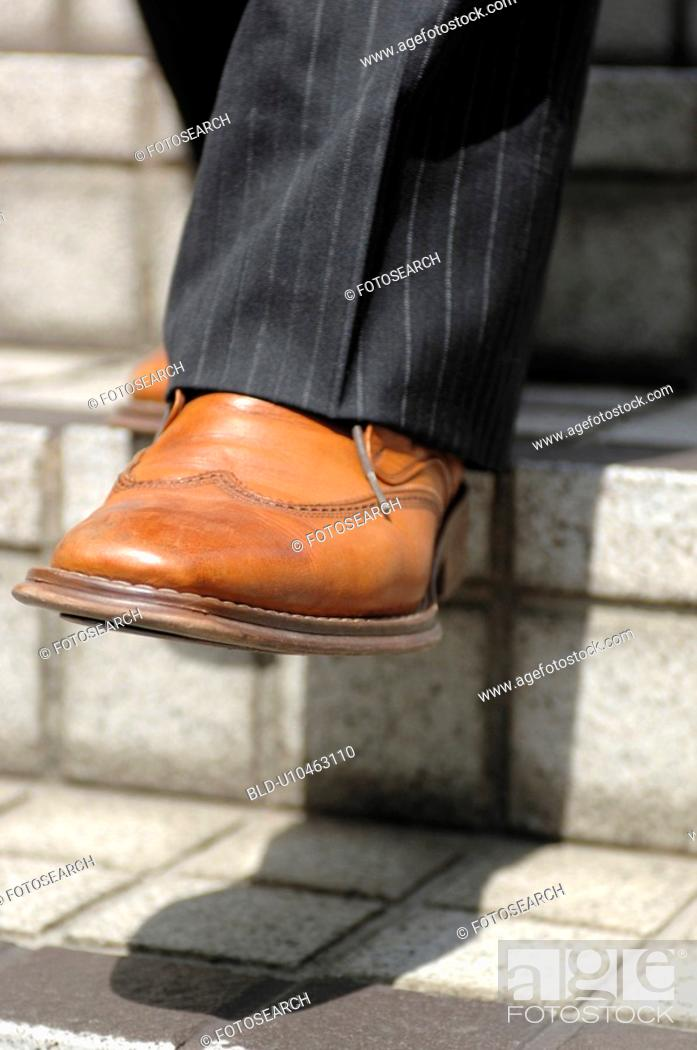 Stock Photo: Foot of the businessman.