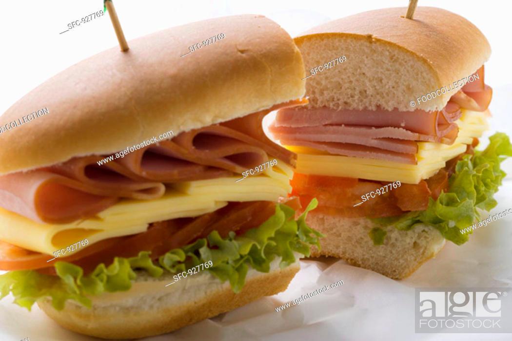 Stock Photo: Sub sandwich, halved, on sandwich wrap.