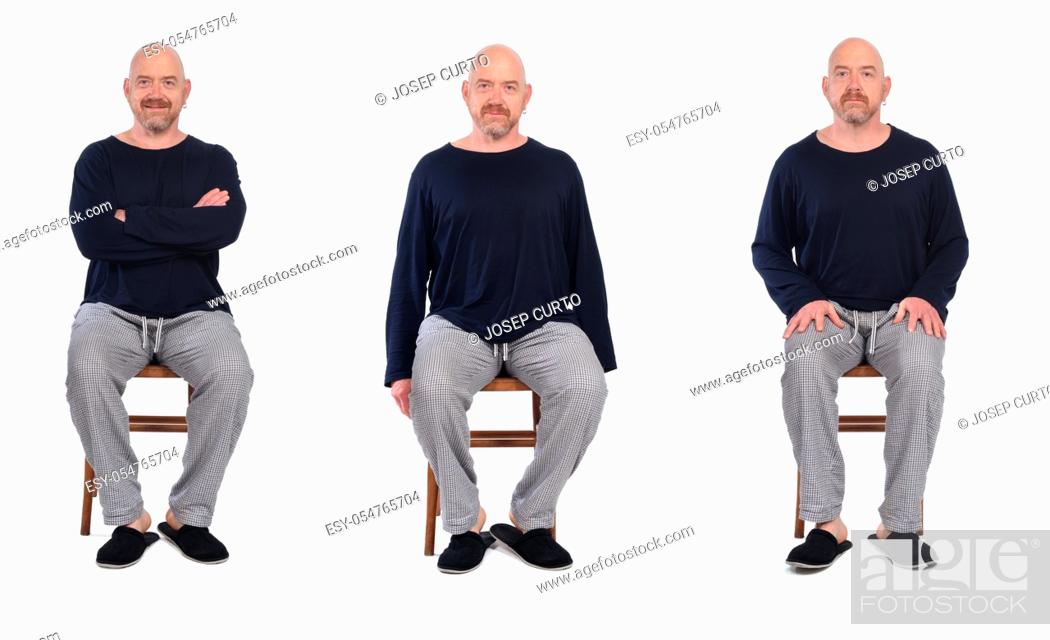 Stock Photo: group of same man in pajamas sitting o a chair on white background, front view.