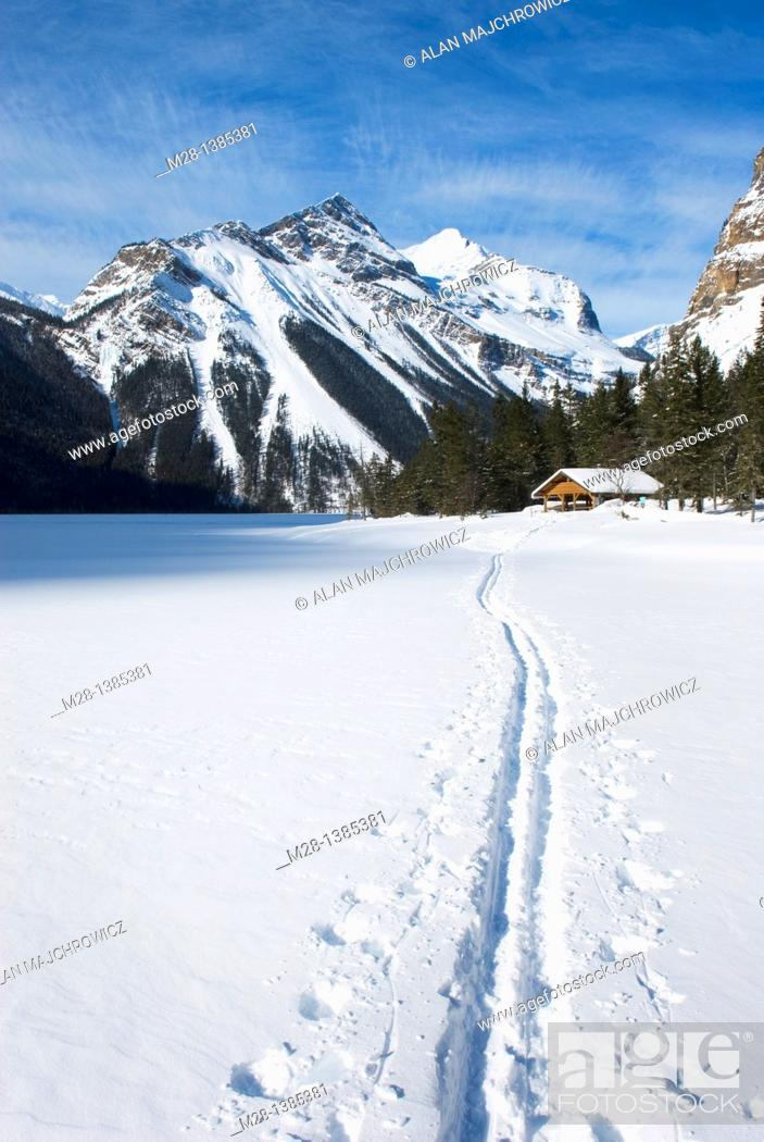 Stock Photo: Backcountry ski track heading to warming shelter on Kinney Lake, Mount Robson Provincial Park British Columbia Canada.
