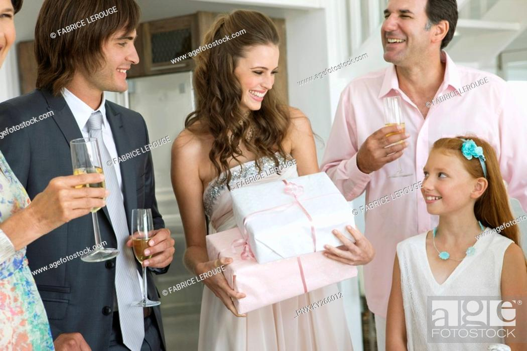 Stock Photo: Bride receiving gifts from guests in a party.