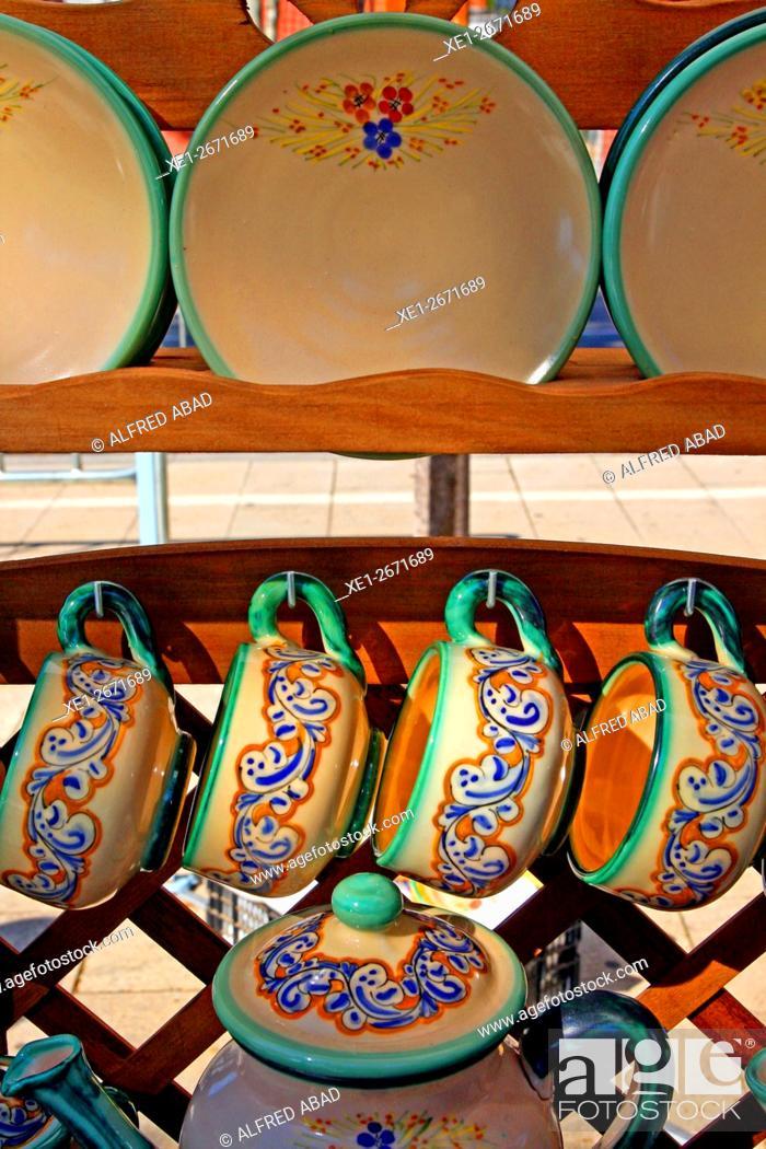 Stock Photo: Ceramics set of cups, saucers and tea pot.