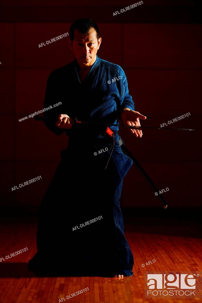 Stock Photo: Japanese sword master performing his craft.