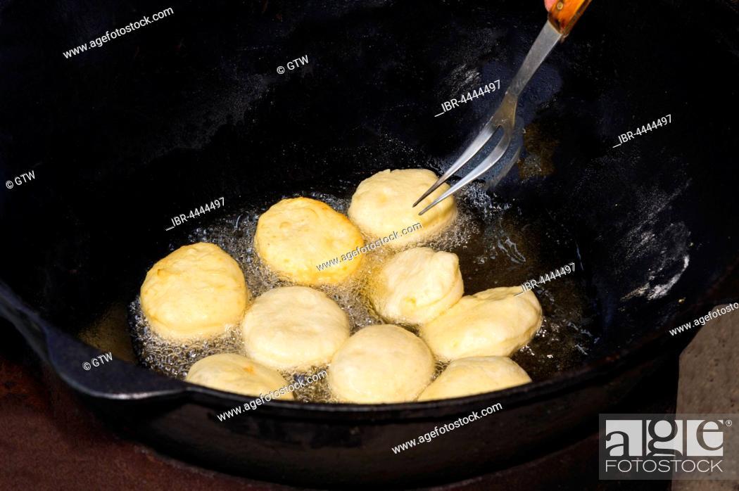 Stock Photo: Preparation of local tandyr bread, Kazakh ethnographic village aul Gunny, Talgar city, Almaty, Kazakhstan.