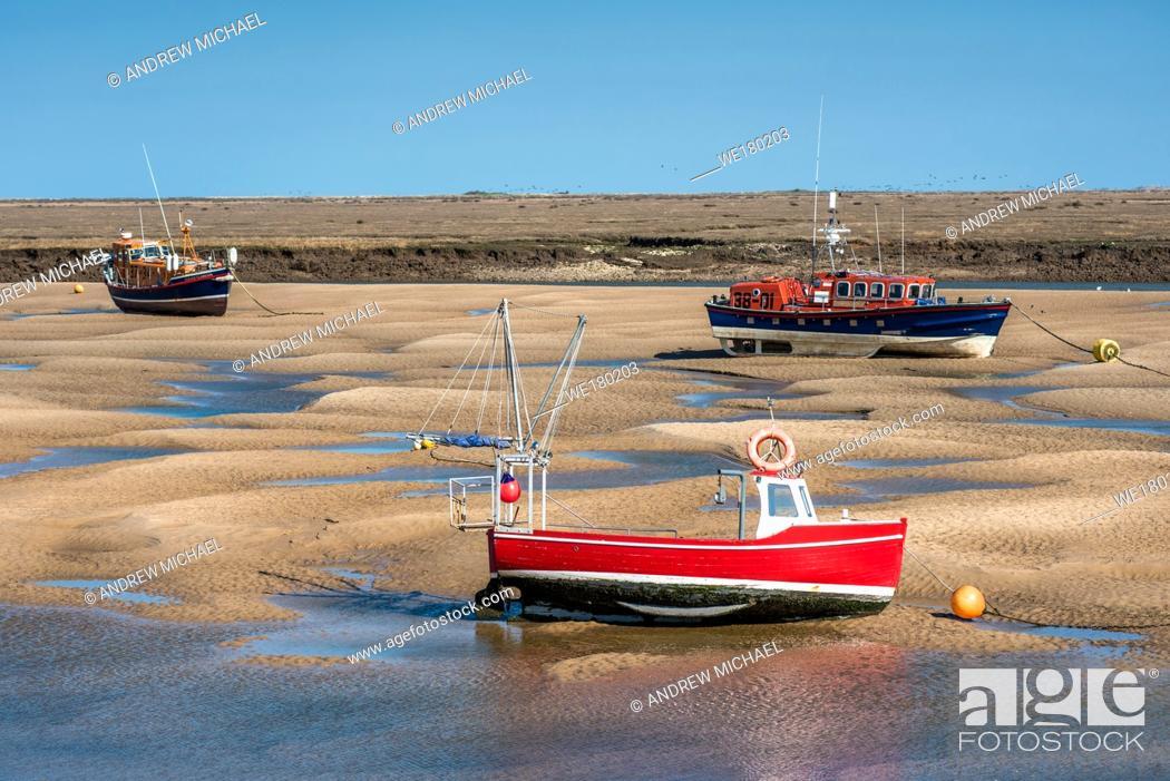 Stock Photo: Lifeboard boats marooned on sandbanks at low tide on East Fleet river estuary at Wells next the sea, North Norfolk coast, East Anglia, England, UK.