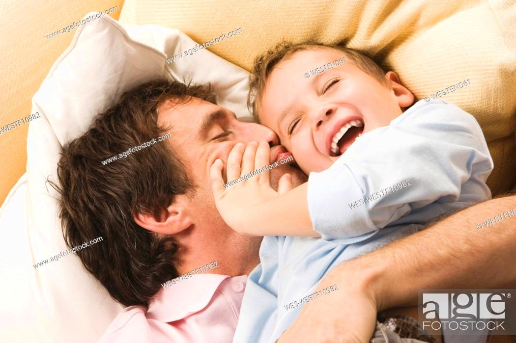 Stock Photo: Father and son 4-5, fooling about, close up.