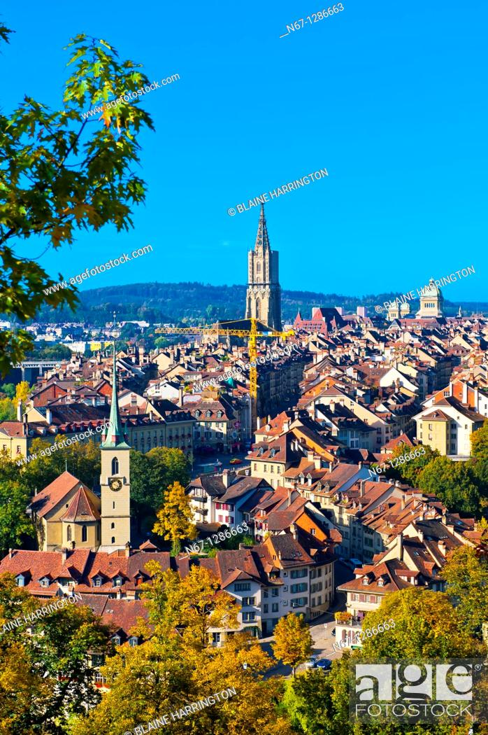 Stock Photo: Cityscape of the medieval city center of Bern with the Munster Cathedral and Federal Palace (Swiss Parliament building) in background.