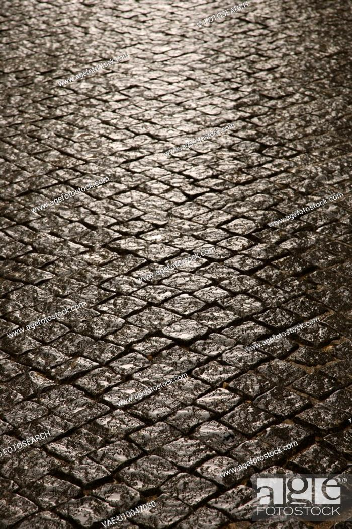 Stock Photo: Stone inlayed street in Lisbon, Portugal.