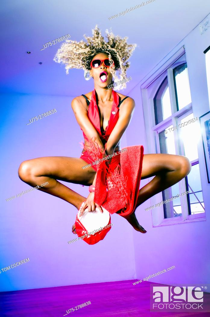Stock Photo: Young African woman jumping.