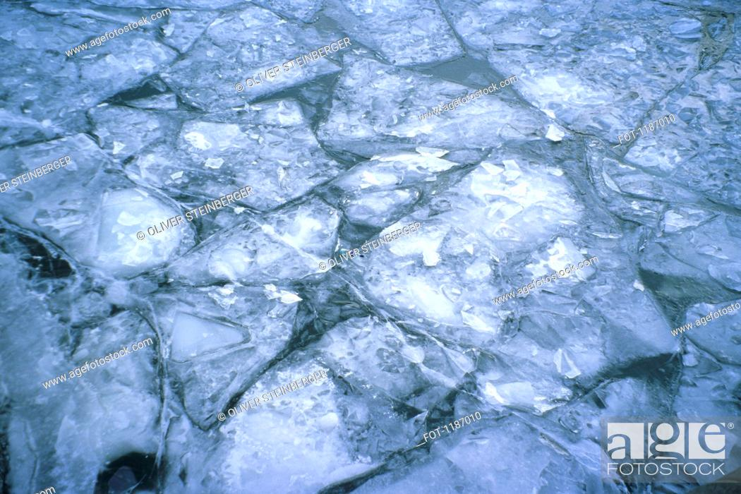 Stock Photo: Patterns of cracked ice on river.