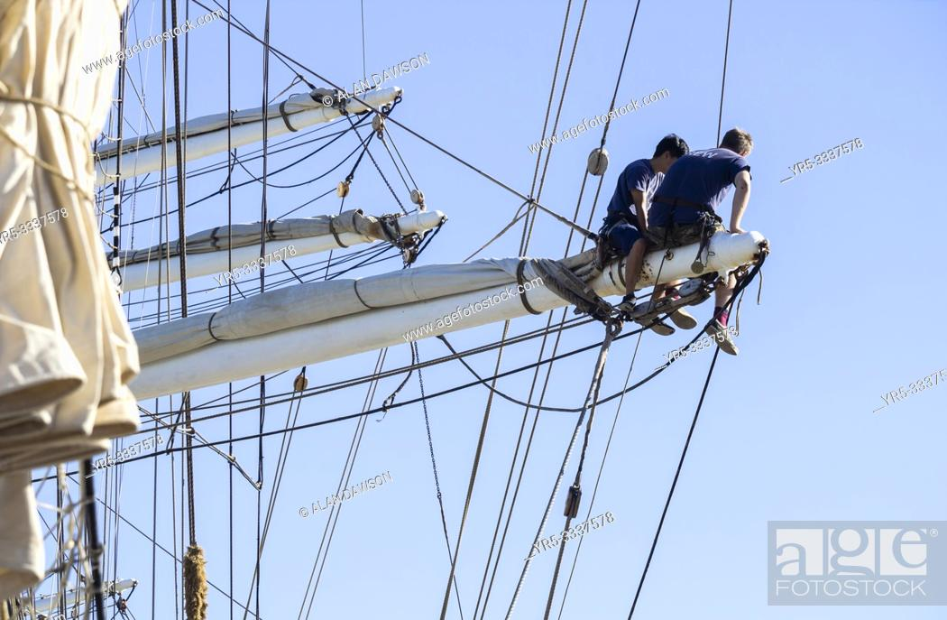 Stock Photo: Las Palmas, Gran Canaria, Canary Islands, Spain. 18th December 2018. Crew of Norwegian tall ship Christian Radich on the rigging.