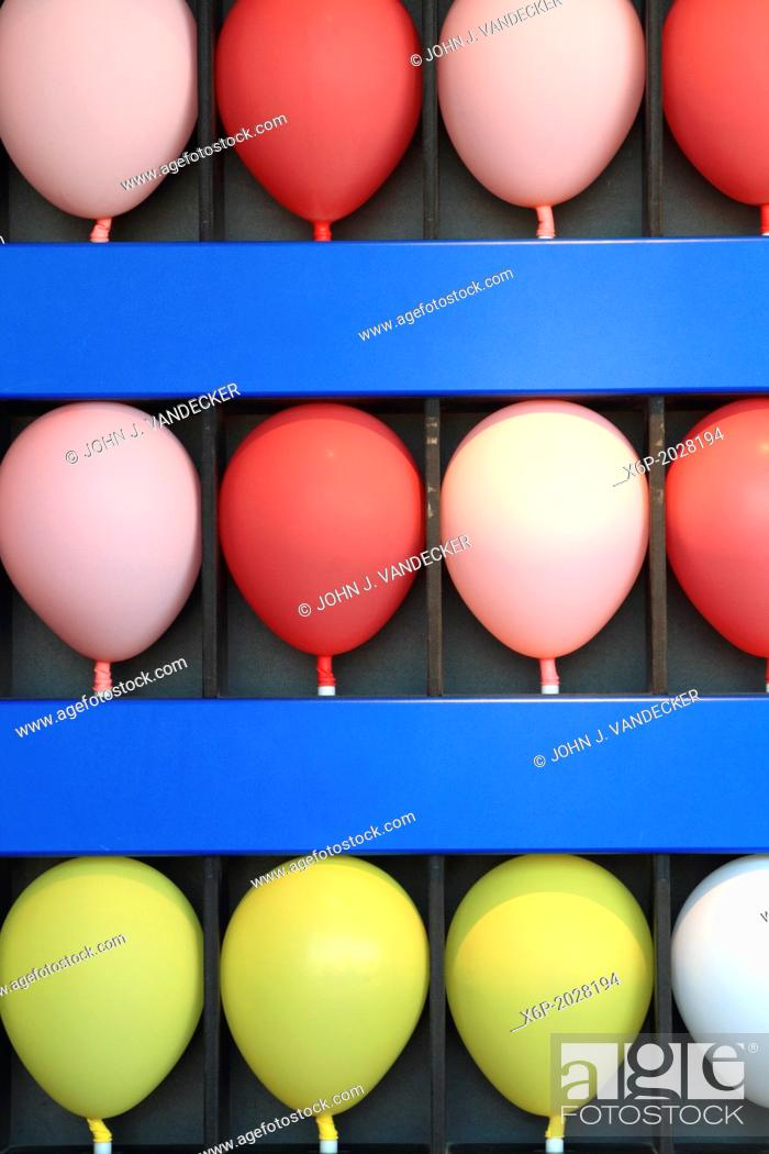 Stock Photo: Inflated balloons at an amusement park dart game. Point Pleasant, New Jersey, USA.