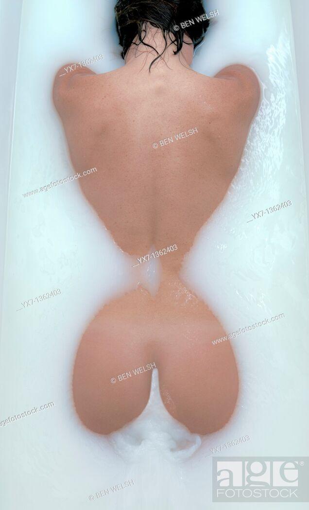 Stock Photo: Female figure, milk bath.