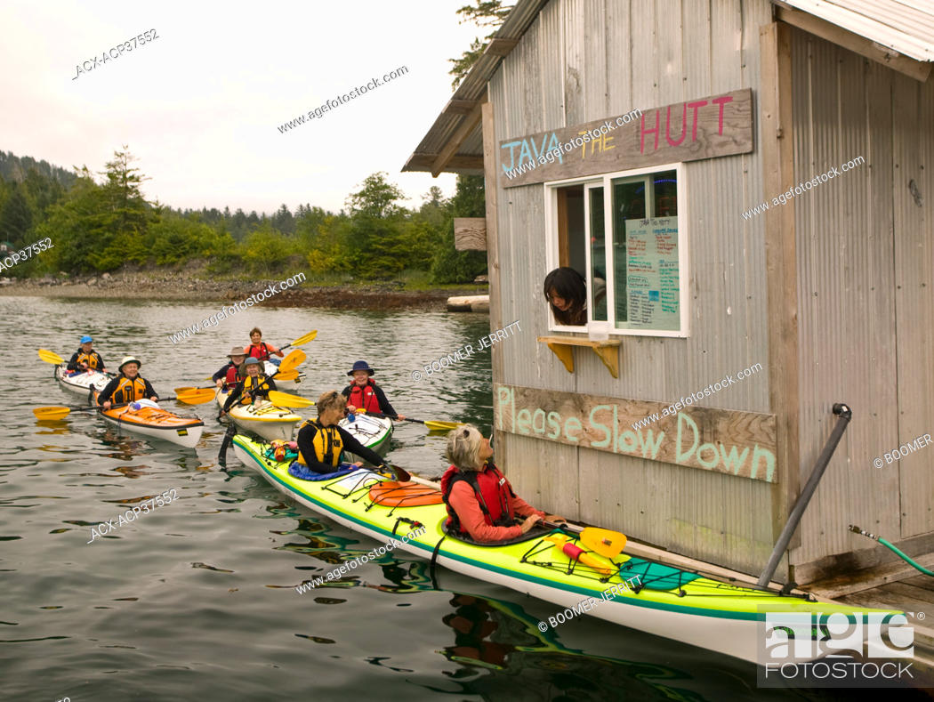 Stock Photo: 'Java The Hutt', a drive through floating coffee shop in the small native village of Kyuquot caters to Kayakers and recreational boaters alike.