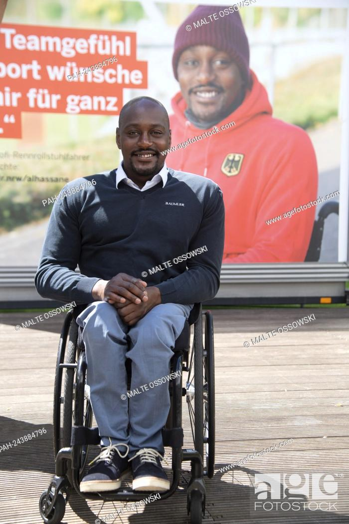 Photo de stock: Alhassane BALDE, racing wheelchair driver, athlete, in front of the poster with his portrait, portrait, cropped single image, single motif.