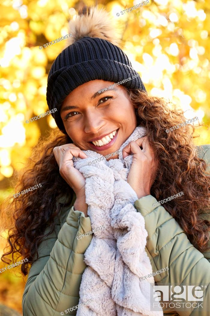 Stock Photo: Outdoor Portrait Of Smiling Woman Wearing Scarf In Autumn.