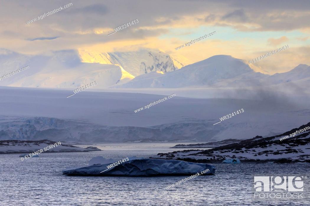 Stock Photo: Sunrise, over misty mountains and tidewater glaciers, Anvers Island, Antarctic Peninsula, Antarctica, Polar Regions.