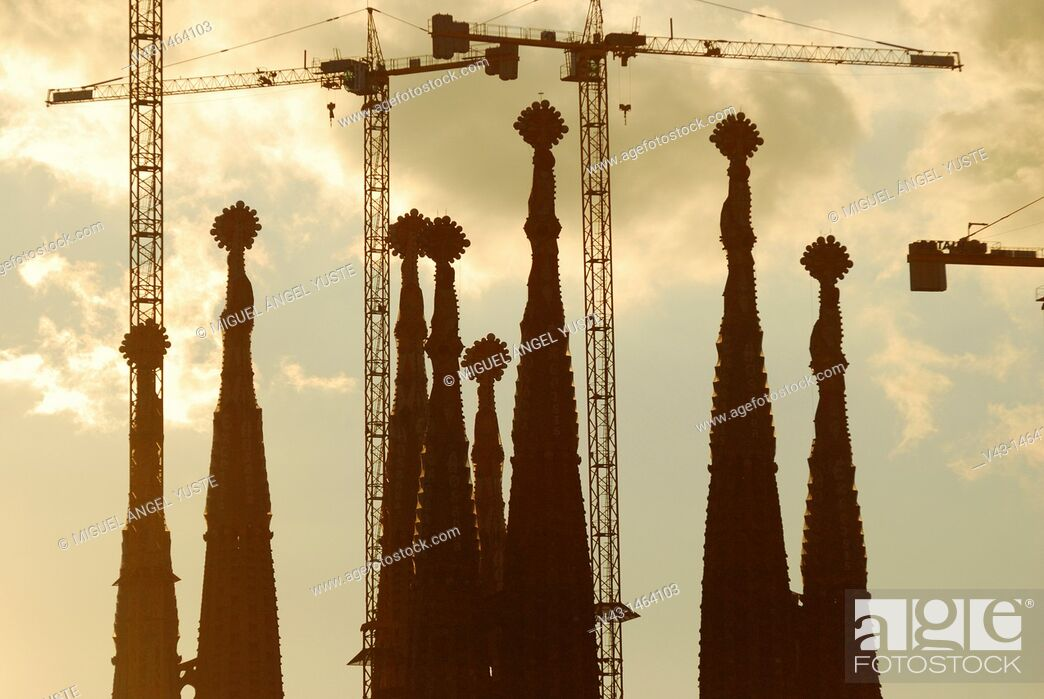 Stock Photo: The Sagrada Familia towers and their cranes at dusk in Barcelona, Catalonia, Spain.