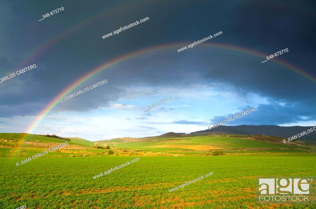 Stock Photo: Rainbow over fields. La Rioja, Spain.