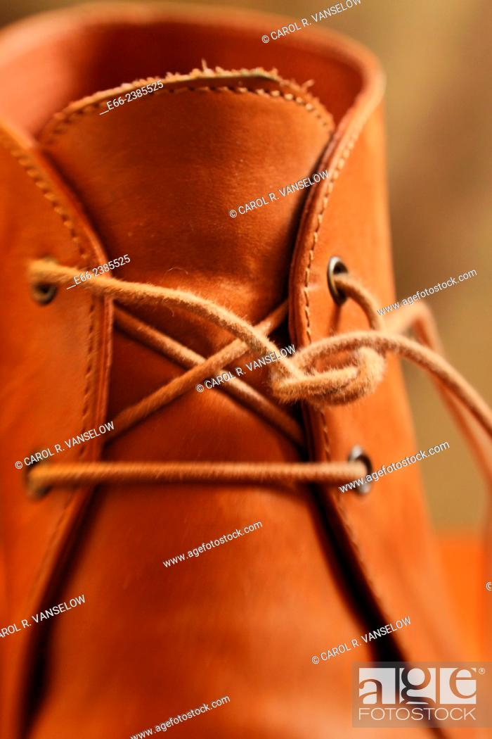 Stock Photo: pair of women's boots with laces undone.