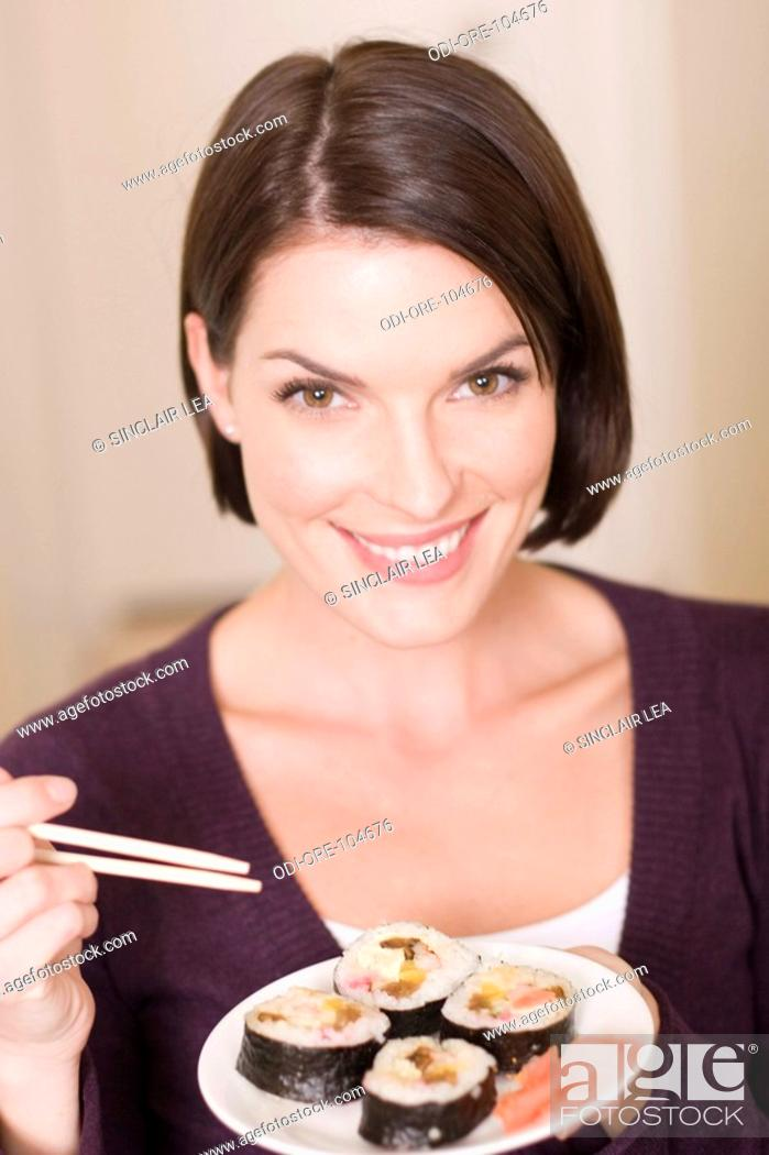 Stock Photo: Woman sushis.