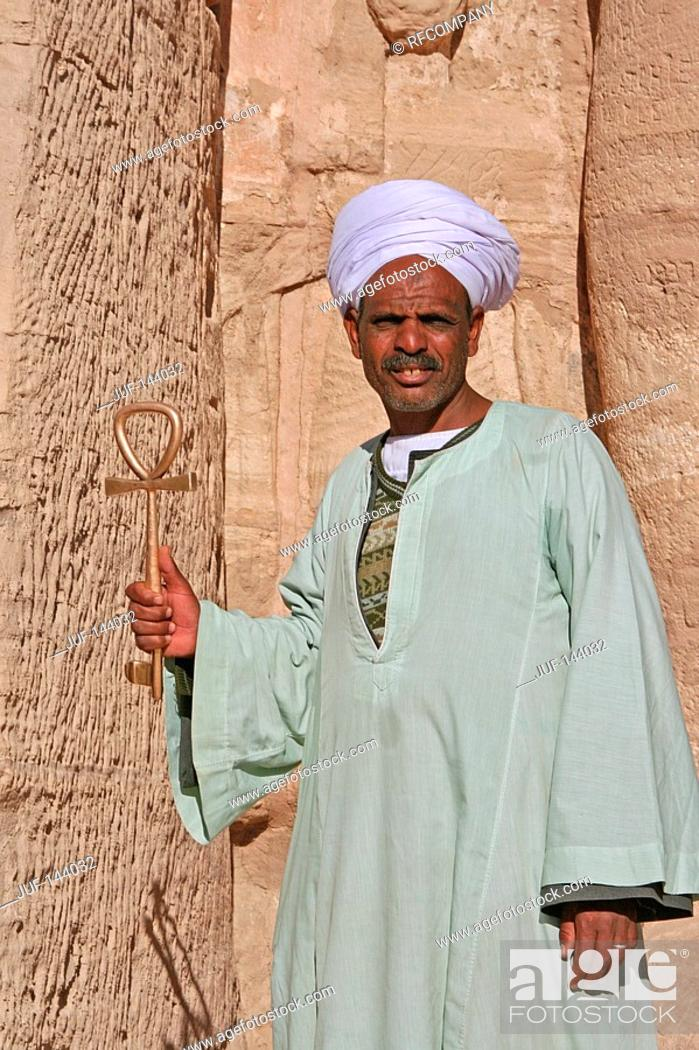Stock Photo: Egyptian in front of temple in Abu Simbel with Ankh.