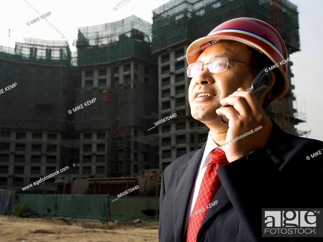 Stock Photo: Architect on the job site.