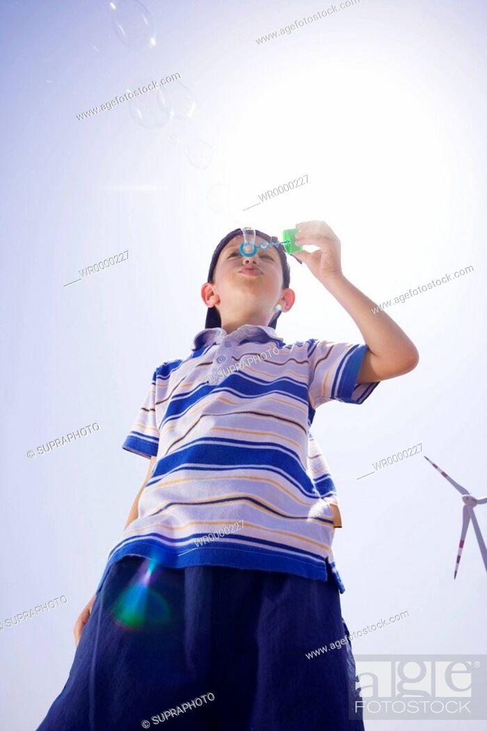 Stock Photo: Little boy soap bubbles.