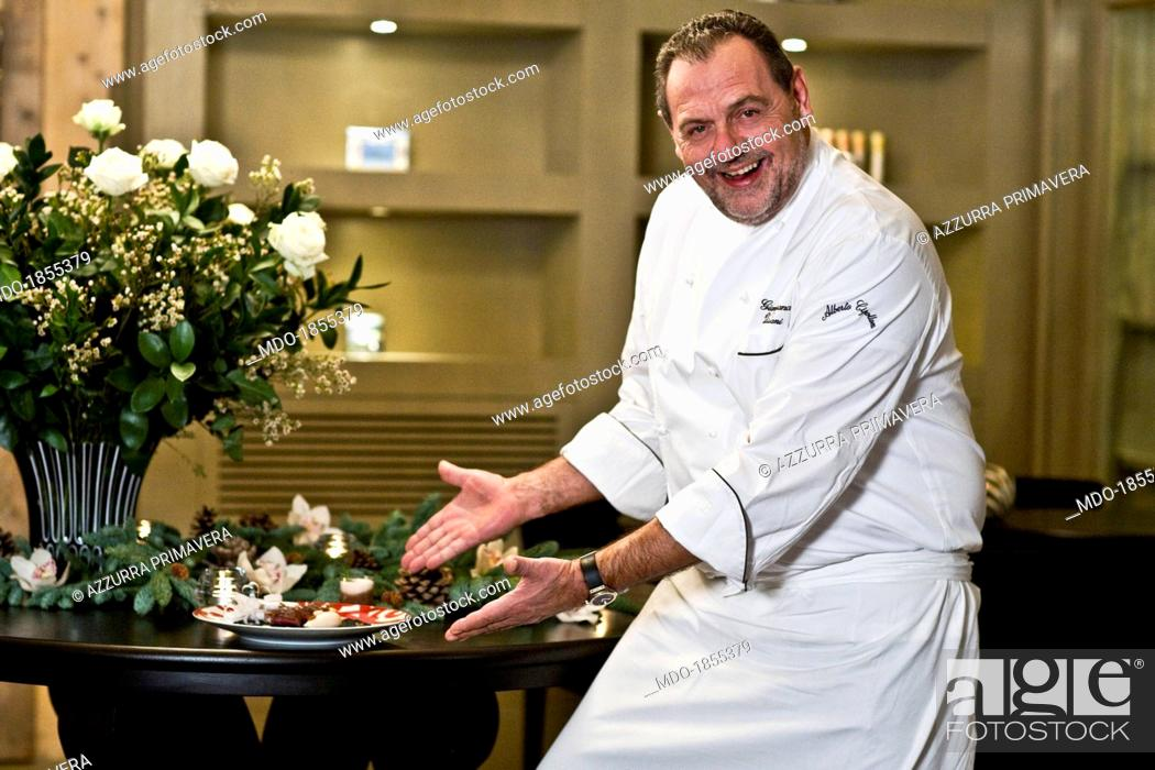 Stock Photo: Italian chef Gianfranco Vissani showing a Christmas meal made by himself for a photocall shooted at his restaurant. Terni (Italy), 29th November 2013.
