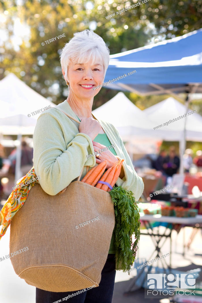 Stock Photo: Mixed race woman shopping at farmerÆs market.