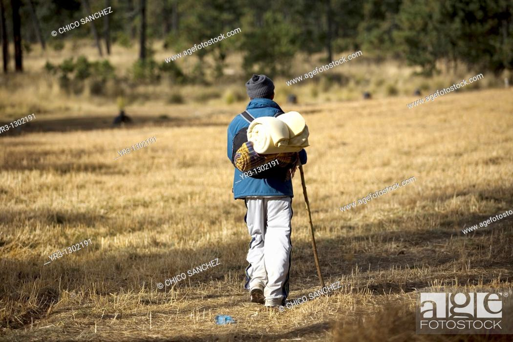 Stock Photo: A pilgrim walks through a field as he travels to reach the Basilica of Guadalupe in Mexico City, December 7, 2008  Hundreds of thousands of Mexican pilgrims.