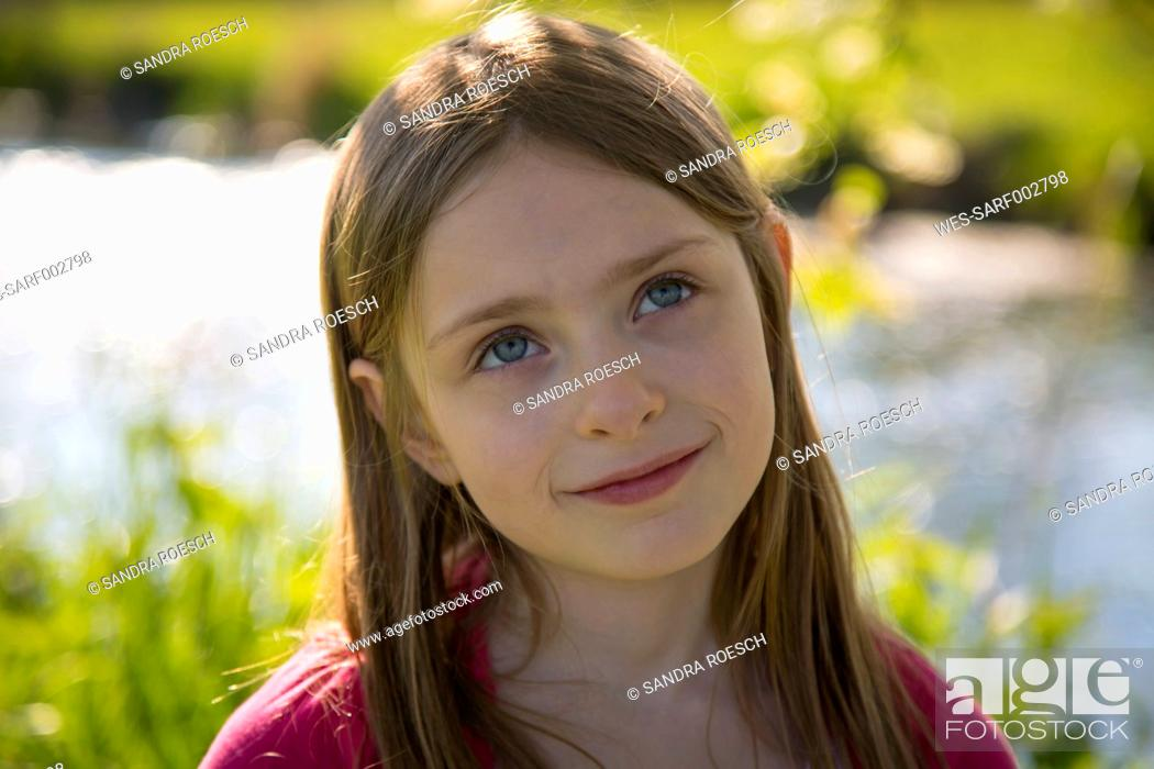 Stock Photo: Portrait of little girl in nature.