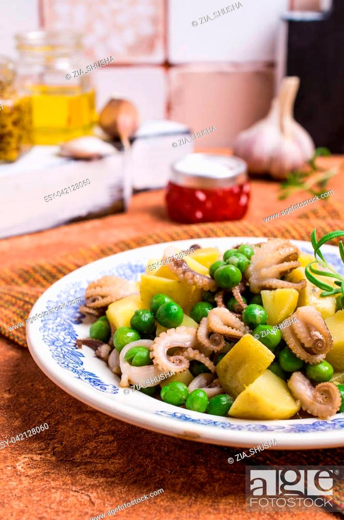 Stock Photo: Octopus with vegetables in the plate on the table. Selective focus.