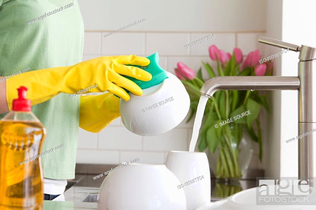 Stock Photo: Woman washing up.