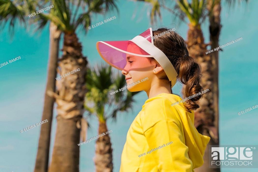 Stock Photo: Little girl wearing sun visor in summer.