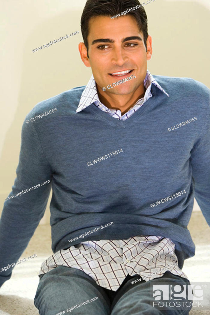 Stock Photo: Close-up of a mid adult man smiling.