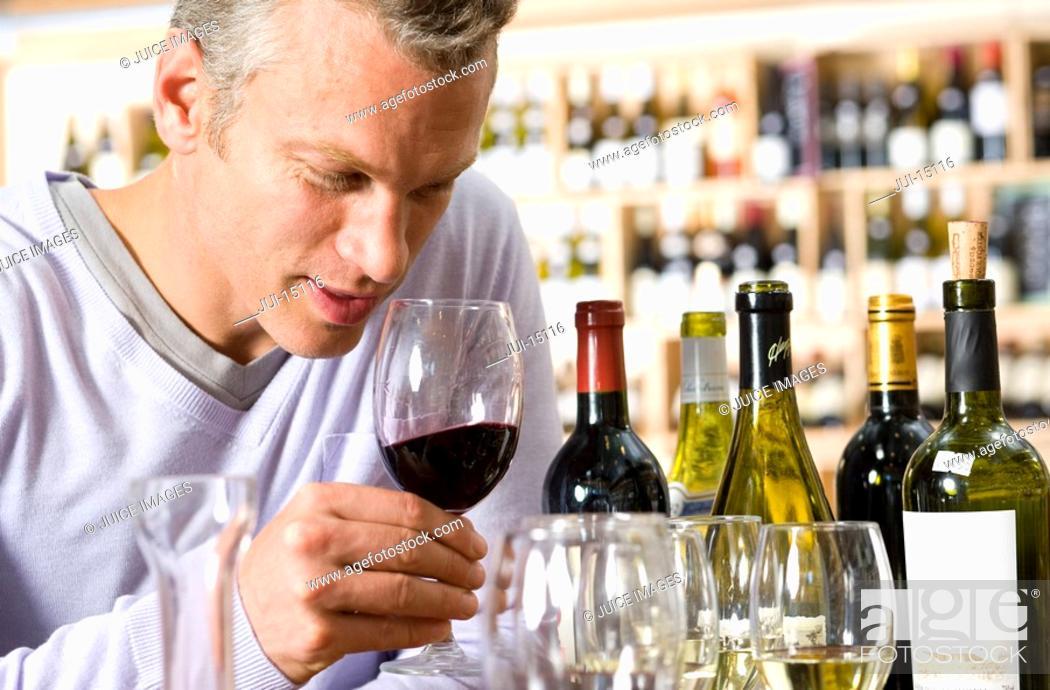Stock Photo: Man tasting wine.